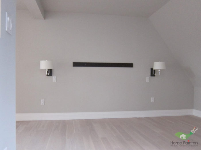 newly painted taupe master bedroom with light wood flooring in the gta by a local home painters service