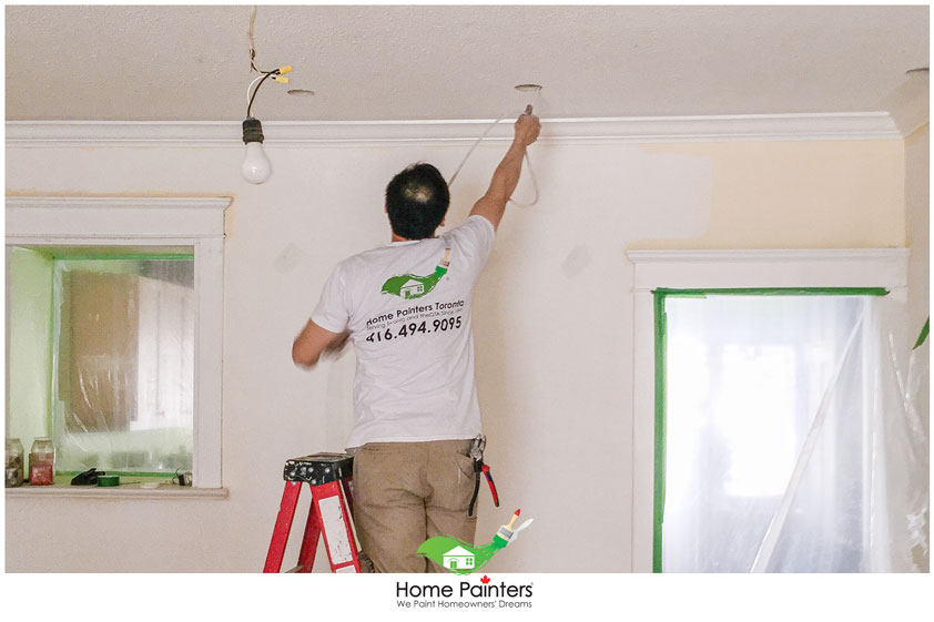 handyman fixing ceiling after a popcorn removal, painting stucco ceiling, how to paint stucco ceiling, how to paint a textured ceiling