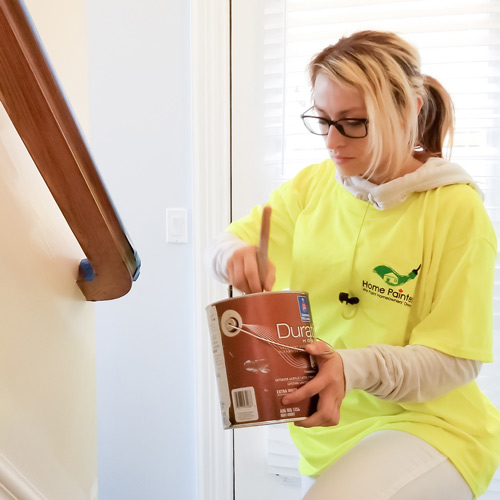 Interior painter from interior painting company Home painters toronto in mississauga working passionately on Home interior colour project, interior painting services, interior painting toronto, is it worth paying someone to paint your house